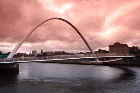 Dusk over the Millenium bridge in Newcastle upon Tyne photo