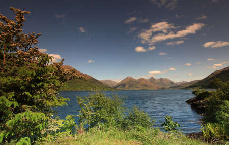 Loch Duich within th Scottish highlands in summer time  Stock Photo