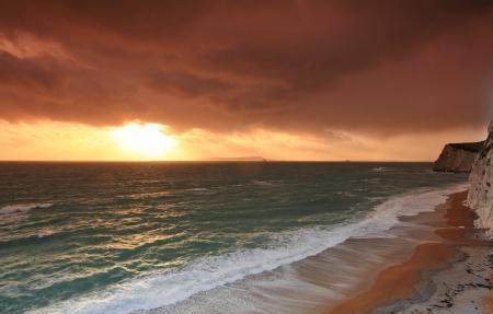 dorset: Sunset over cliffs at Dorset England Stock Photo