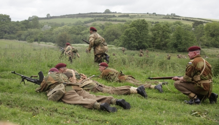 troops: British world war 2 troops in action with american troops in the back ground