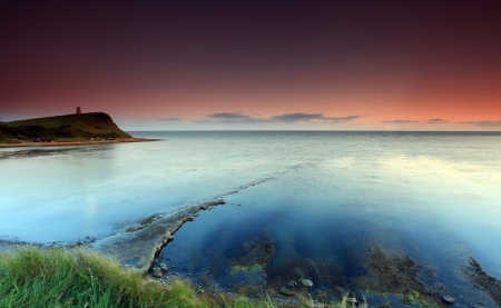 Kimmridge Bay at dusk dorset england photo