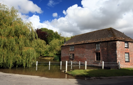 English village pond next to river cottage in Cerne Abbas Dorset Stock Photo - 14803106