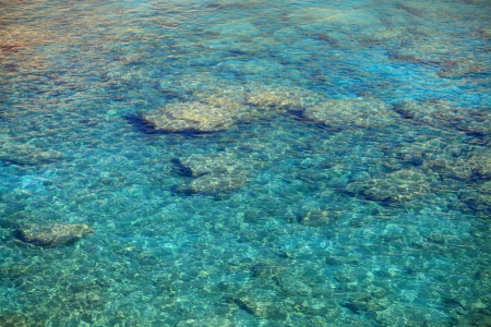 Crystal clear waters at Anthony Quinn Bay in Greece