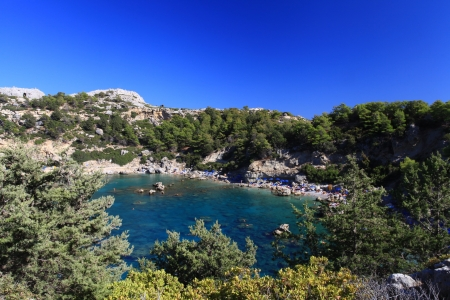 snorkle: Tourists swim and play in Crystal clear waters at Anthony Quinn Bay in Greece