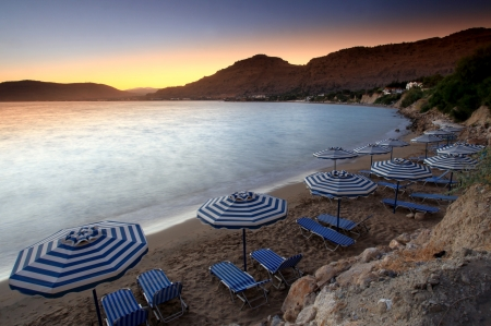 Sunset over Pefkos beach in Rhodes in Greece