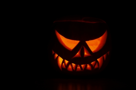 Pumpkin carved into spooky demon face for haloween Stock Photo - 15697950
