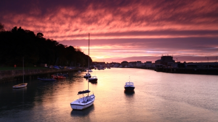 Entrance to weymouth harbour at dusk in southern england Stock Photo