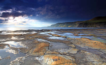 Sunlight at on the souther british coast line photo