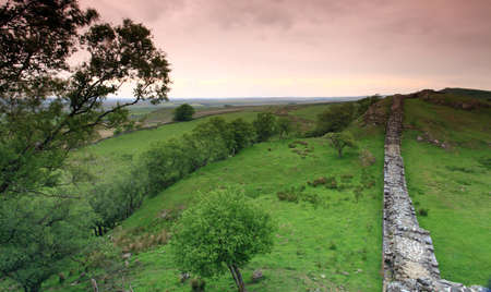 The ancient roman remains of hadrians wall on the english scotish boarder in the un ited kingdom photo