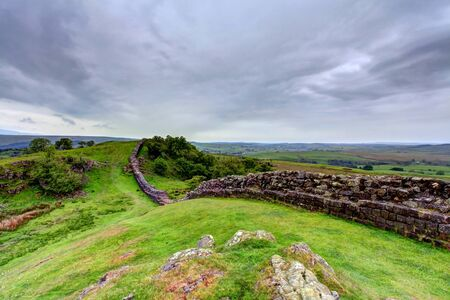 The ancient roman remains of hadrians wall on the english scotish boarder in the un ited kingdom