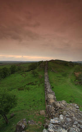scotish: The ancient roman remains of hadrians wall on the english scotish boarder in the un ited kingdom