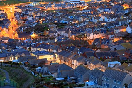 Terraced houses at night time on portland dorset photo