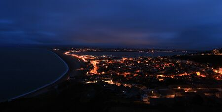 Street lights light up the causway at Chesil Beach Fortuneswell Portland Dorset photo
