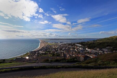 Chesil beach and Weymouth harbour Dorset home of the 2012 olympic sailing Stock Photo