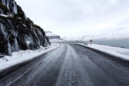 Open frozen roads in icelands east fjords in mid winter photo