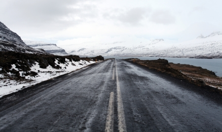 Open frozen roads in icelands east fjords in mid winter