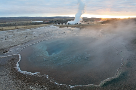 Strokkur Geyser and hot spring in Iceland erupting at sunset in winter photo