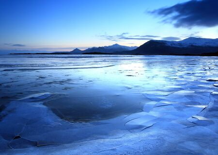 Ice shapes in the east fjords iceland at sunset in winter Stock Photo