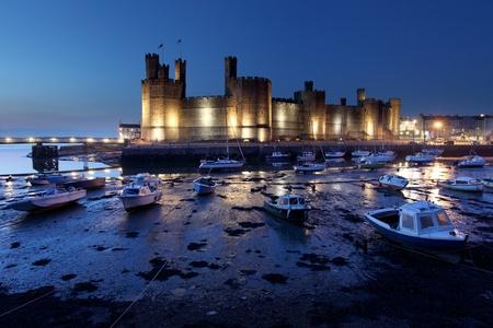 Medievil Caernarfon castle at twilight in north Wales