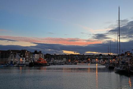 quayside: Sunset over Weymouth Quayside Early Autumn Stock Photo