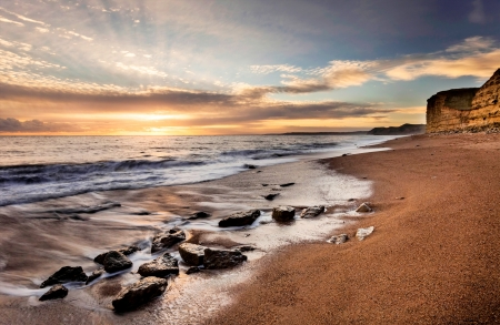 Famous Jurassic Coast Cliffs at Burton Bradstock and West Bay Dorset England Stock Photo