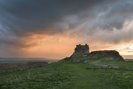 stargazing: Dawn breaks over Lindisfarne Castle on Holy Island Northumberland