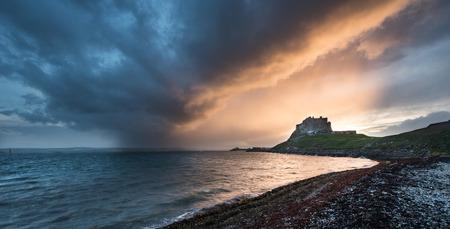 Sunset over Lindisfarne Castle on Holy Island Northumberland