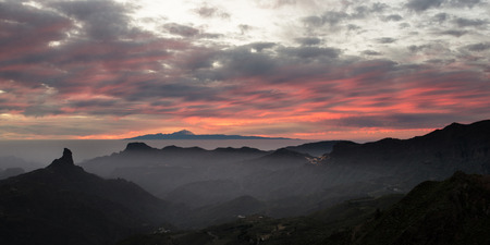 Roque Nublo Sunset Gran Canaria looking out to Tenerife in the Canary Isles Stock Photo
