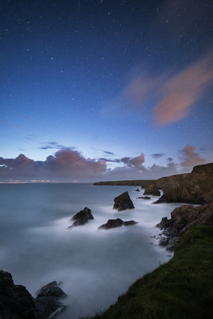 A star lit night sky over Bedruthan Steps in Cornwall