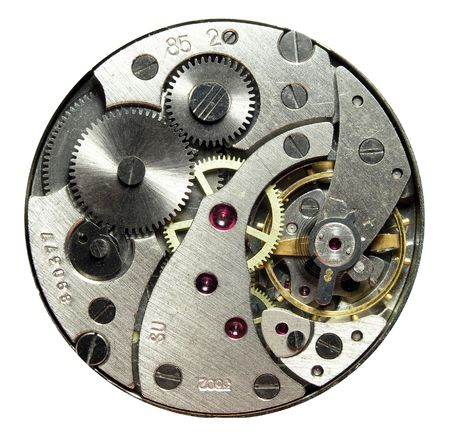 opened clockwork of round watch against white backgroud