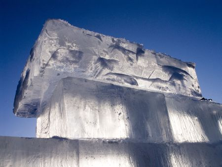 big translucent ice blocs in the sunshine: preparations for the ice sculpture festival