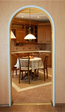 conveniences: cozy kitchen: walnut suite of furniture, built-in equipment, pretty round table, wooden chairs; warm calm colours