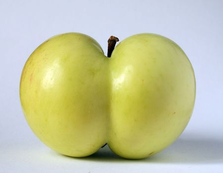 green apple of a queer funny shape
