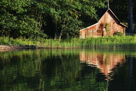 boathouse: the old wooden boat-house on the seashore