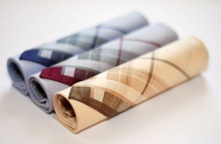 handkerchiefs: three men`s elegant handkerchiefs against the white background Stock Photo