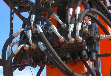 hydraulic hoses: close-up of fluid power system of manipulator                                     Stock Photo