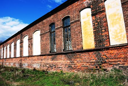 blasted: old blasted house in park with brickwall                                    Stock Photo