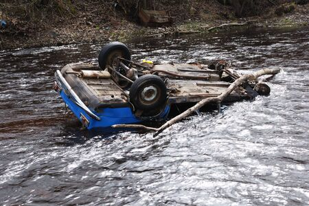 car in the river upsidedown; head over heels