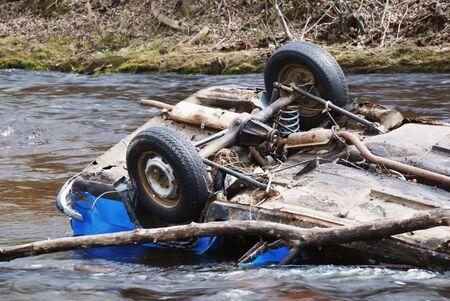 car in the river upsidedown; head over heels