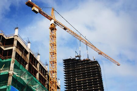 building site: high-rise buildings and a tower crane Stock Photo