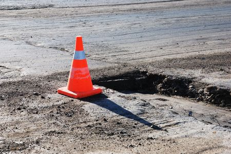 road building, asphalt, orange sign and pot-hole Stock Photo