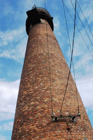 the water tower: old brick water tower against blue sky Stock Photo