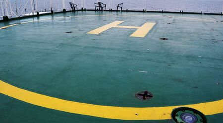 helicopter pad: helideck on a ferryboat at sea horizontal