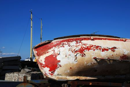 old boat with cracked paint in port photo