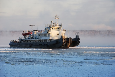 icing tugboat in winter after the storm photo