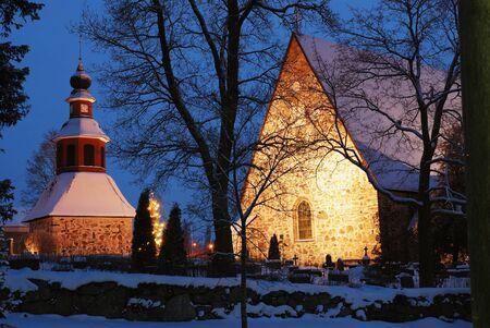 winter finland: christmas night scenery in Finland, church in snow, xmas tree
