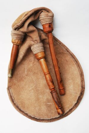 social history: close-up of bagpipe from Scotland over white