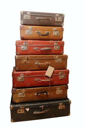 Pile of battered old suitcases and trunks in poor condition Standard-Bild
