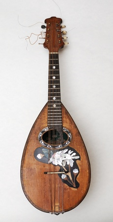 old mandolin with pearl incrustation over white