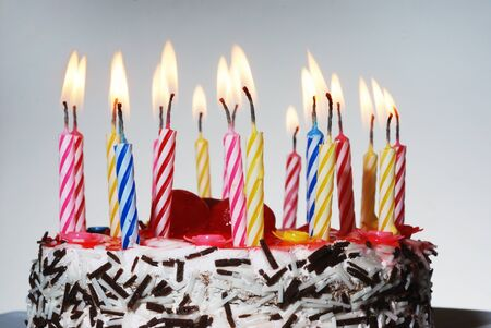 a birthday cake with lighted candles, horizontal photo  photo